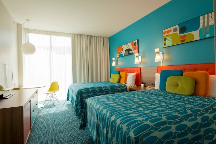Two large beds and bright window at Cabana Bay Beach Resorts Family Suite in Orlando Florida