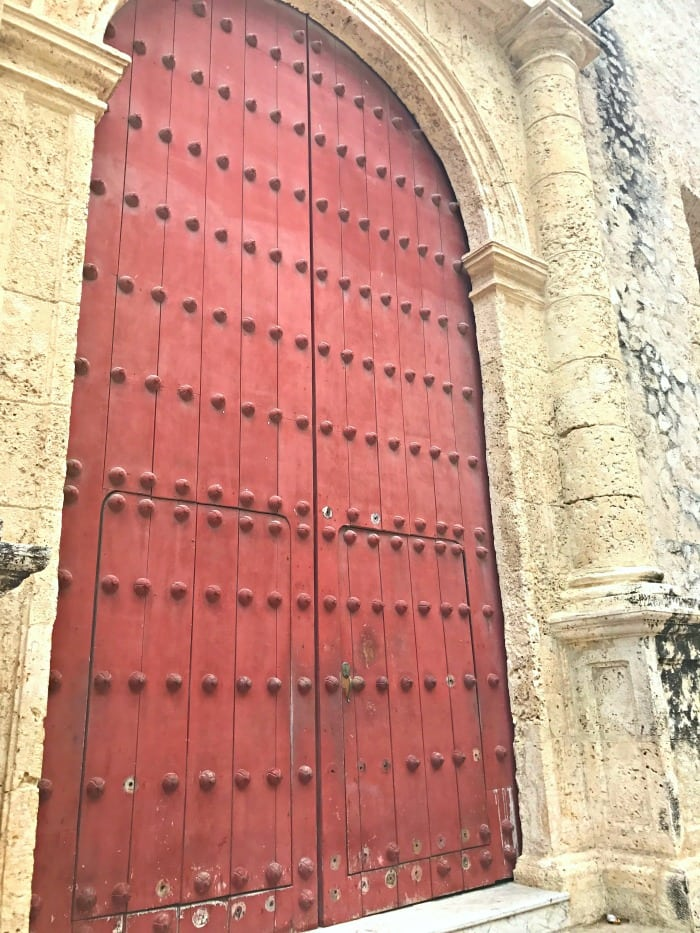 bright red door in cartagena colombia